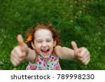 Laughing Girl With Daisy In He...