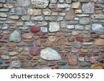 Small photo of unregular natural stone wall background