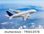 passenger plane flies high over ... | Shutterstock . vector #790013578