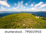 Grassy Slopes And Boulders Of...
