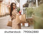 woman shopping outside | Shutterstock . vector #790062880