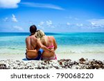 couple in embrace sitting on... | Shutterstock . vector #790068220