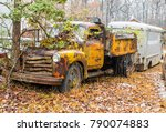 Two Abaondoned Trucks With A...