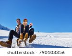 young couple sledding and... | Shutterstock . vector #790103356