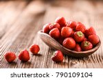 strawberries in wooden bowl.... | Shutterstock . vector #790109104
