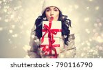 Young Woman Holding Stack Of...