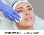 the cosmetologist cleanses with ... | Shutterstock . vector #790119004