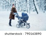 young beautiful mother in a fur ... | Shutterstock . vector #790163890