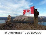 man holding canada flag on... | Shutterstock . vector #790169200