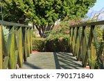scenic green wooden foot bridge ...   Shutterstock . vector #790171840