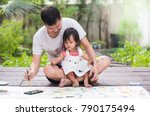 asian father and daughter are... | Shutterstock . vector #790175494