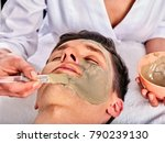 mud facial mask of woman in spa ... | Shutterstock . vector #790239130