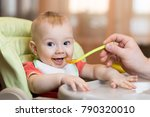 baby eating food with parent... | Shutterstock . vector #790320010