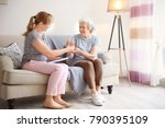 caregiver giving glass of water ... | Shutterstock . vector #790395109