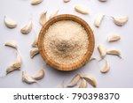 garlic lahsun powder is ground  ... | Shutterstock . vector #790398370