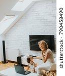 little girl looking at laptop... | Shutterstock . vector #790458490