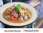 Small photo of Turkey stew with carrots, onions and celery, horizontal
