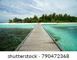A narrow wooden bridge on...