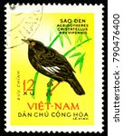 Small photo of Ukraine - circa 2018: A postage stamp printed in Vietnam shows bird Crested Myna or Acridotheres cristatellus. Series: Birds. Circa 1963.