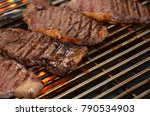 beef steaks on the grill with... | Shutterstock . vector #790534903