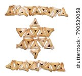 Small photo of Haman's ears or hamantashen, Jewish traditional filled Purim cookies in a shape of the Star of David