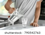 morning of young man pouring... | Shutterstock . vector #790542763