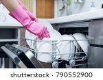 housewife taking out clean... | Shutterstock . vector #790552900