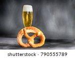 fresh pretzel and a glass of...   Shutterstock . vector #790555789