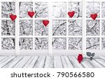 Small photo of Home interior for Valentines day with window, hanging handmade hearts and rose lying on table. Copy space. Empty place for your decoration.