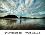 Silhouette Of Fisherman Is...