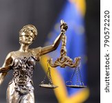 Small photo of Scales of justice , Lady Justice in front of Flag of European union , European union law concept.