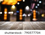 empty wooden table with blur... | Shutterstock . vector #790577704