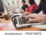 a man is typing something on a... | Shutterstock . vector #790579870