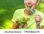 woman eating healthy salad from ... | Shutterstock . vector #790586674