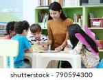 Small photo of Young asia woman teacher teaching kids in kindergarten classroom, preschool education concept