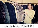 smiling girl deciding on short... | Shutterstock . vector #790600150