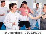 women with men are practicing... | Shutterstock . vector #790624108