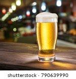 frosty glass of light beer on... | Shutterstock . vector #790639990