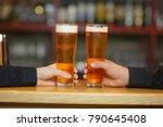 two men cling to full glasses... | Shutterstock . vector #790645408