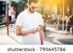 a stylish man with a tattoo and ... | Shutterstock . vector #790645786