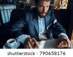 business man in a cafe  work    ... | Shutterstock . vector #790658176