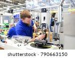 operator assembles machine in a ... | Shutterstock . vector #790663150