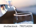 pour water into the glass in... | Shutterstock . vector #790714354