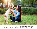 Stock photo beautiful indian girl with her cocker spaniel dog 790722853