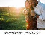 Couple With A Glass Of Wine An...