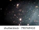abstract glitter bokeh on black ... | Shutterstock . vector #790769410