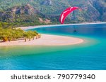 paraglider flies in the sky  ... | Shutterstock . vector #790779340