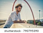 one handsome young man in urban ... | Shutterstock . vector #790795390