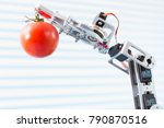 robot holds an tomato in his arm | Shutterstock . vector #790870516