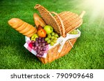picnic basket on grass in park | Shutterstock . vector #790909648